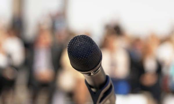 Modern stage microphone against blurred background
