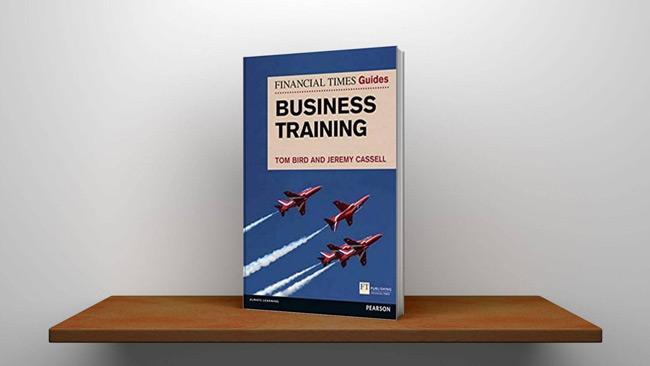 Business training book on shelf